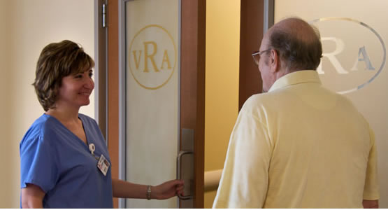 Image of nurse speaking with a patient at the Vero Radiology entrance